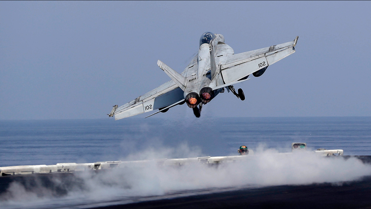 In this picture taken on Monday, Nov. 21, 2016, a U.S. Navy fighter jet takes off from the deck of the U.S.S. Dwight D. Eisenhower aircraft carrier.