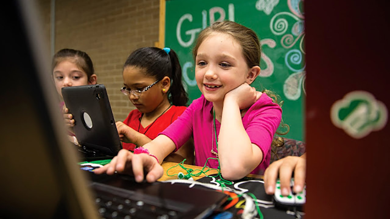 Image of a Girl Scout on a computer.