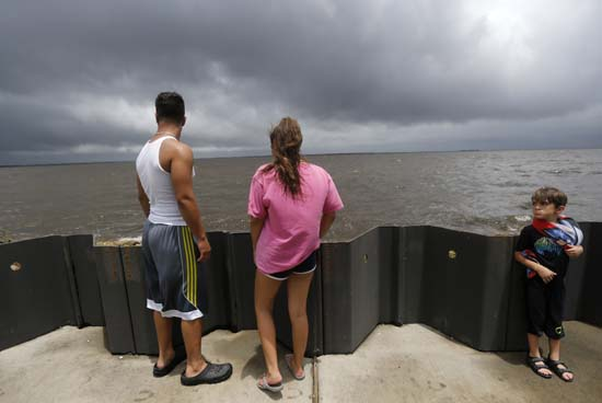 <div class='meta'><div class='origin-logo' data-origin='AP'></div><span class='caption-text' data-credit='Gerald Herbert'>Jonas Cheramie, left, and his sister Lainey Cheramie, watch storm clouds from Tropical Storm Cindy, as they babysit A.J. Aaron, 5, in Lafitte, La., Wednesday, June 21, 2017.</span></div>