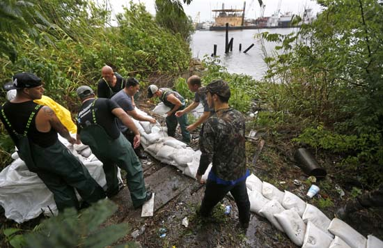 <div class='meta'><div class='origin-logo' data-origin='AP'></div><span class='caption-text' data-credit='Gerald Herbert'>Volunteers put out sand bags due to the arrival of Tropical Storm Cindy in Lafitte, La., Wednesday, June 21, 2017.</span></div>