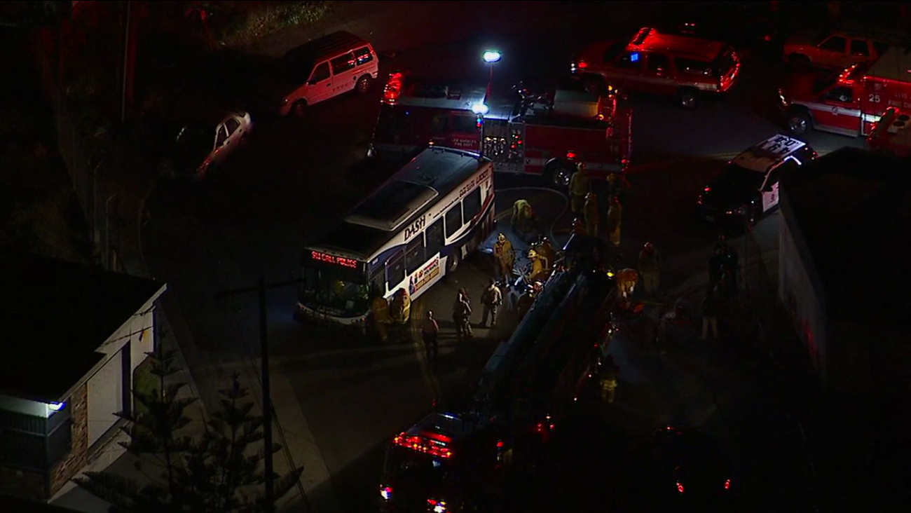 Firefighters surrounded an LADOT bus after it struck a female pedestrian in East Los Angeles on Wednesday, June 21, 2017.