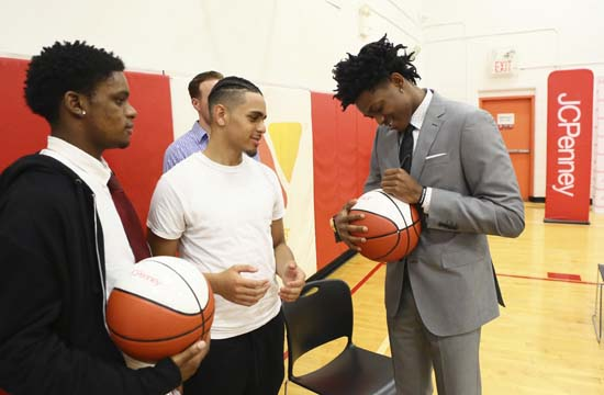 <div class='meta'><div class='origin-logo' data-origin='AP'></div><span class='caption-text' data-credit='AP'>NBA Draftee De'Aaron Fox signs basketballs for fans of the YMCA's Leaders Club at the JCPenney &#34;Suit It Forward.&#34; (Stuart Ramson/AP Images for JCPenney)</span></div>