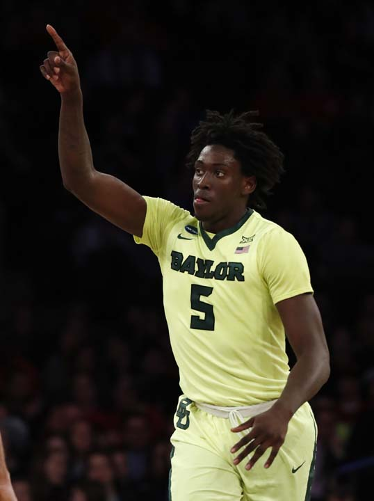 <div class='meta'><div class='origin-logo' data-origin='AP'></div><span class='caption-text' data-credit='AP'>Baylor forward Johnathan Motley (5) reacts after scoring against South Carolina in the first half of an East Regional semifinal game. (AP Photo/Julio Cortez)</span></div>
