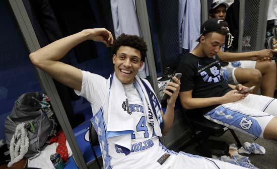 <div class='meta'><div class='origin-logo' data-origin='AP'></div><span class='caption-text' data-credit='AP'>North Carolina forward Justin Jackson talks on his cell phone in the locker room after the championship game against Gonzaga. (AP Photo/Mark Humphrey)</span></div>