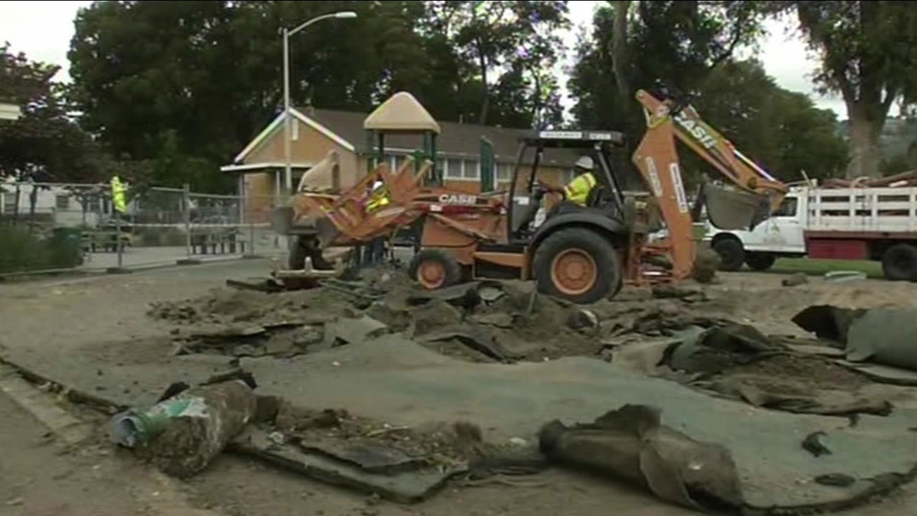 Construction crews tear down Concordia Park's old playground in Oakland.