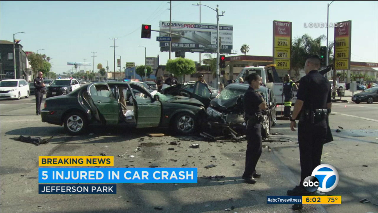 Five people were rushed to the hospital after three cars collided in a violent crash in Jefferson Park Saturday afternoon.