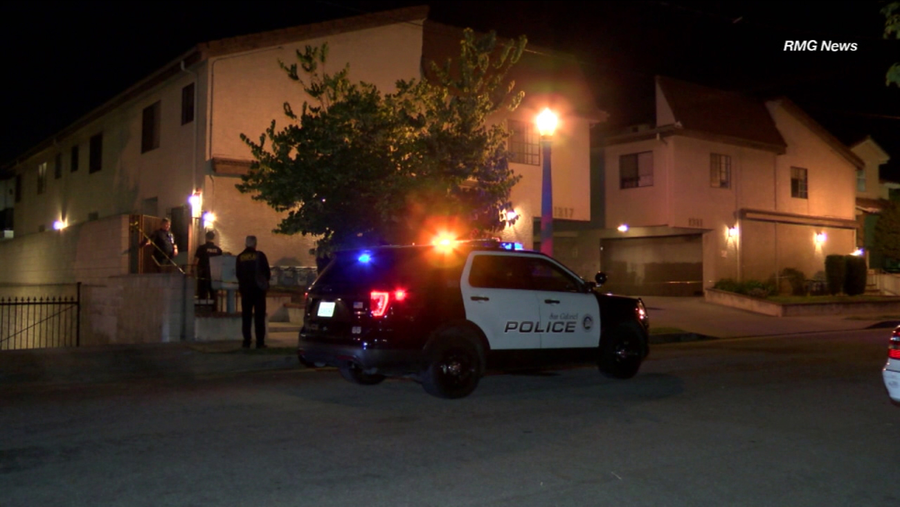 Police are seen outside an apartment building in San Gabriel after two people were found dead Saturday, June 24, 2017.
