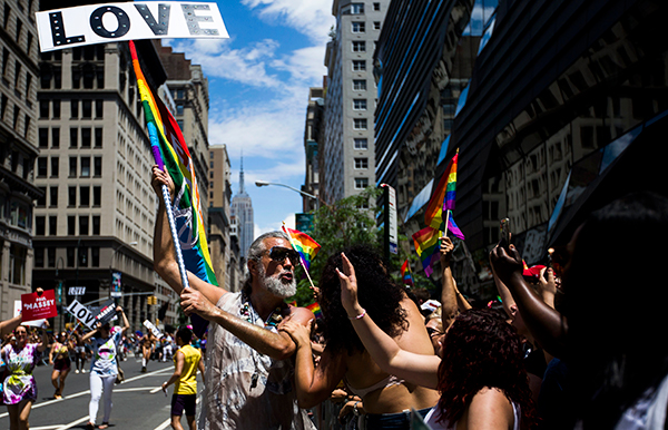 <div class='meta'><div class='origin-logo' data-origin='AP'></div><span class='caption-text' data-credit=''>Steven Menendez blows a kiss while participating in the New York City Pride Parade on Sunday, June 25, 2017 in New York. (AP Photo/Michael Noble Jr.)</span></div>