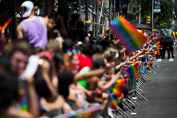 <div class='meta'><div class='origin-logo' data-origin='AP'></div><span class='caption-text' data-credit=''>Members of the crowd line the street with rainbow flags as they watch the New York City Pride Parade on Sunday, June 25, 2017 in New York. (AP Photo/Michael Noble Jr.)</span></div>