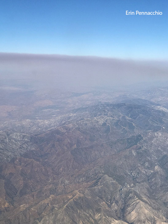 "<div class=""meta image-caption""><div class=""origin-logo origin-image kabc""><span>KABC</span></div><span class=""caption-text"">Thick, smoky haze from the Placerita fire in Santa Clarita is seen from a plane flying above the area on Sunday, June 25, 2017.</span></div>"