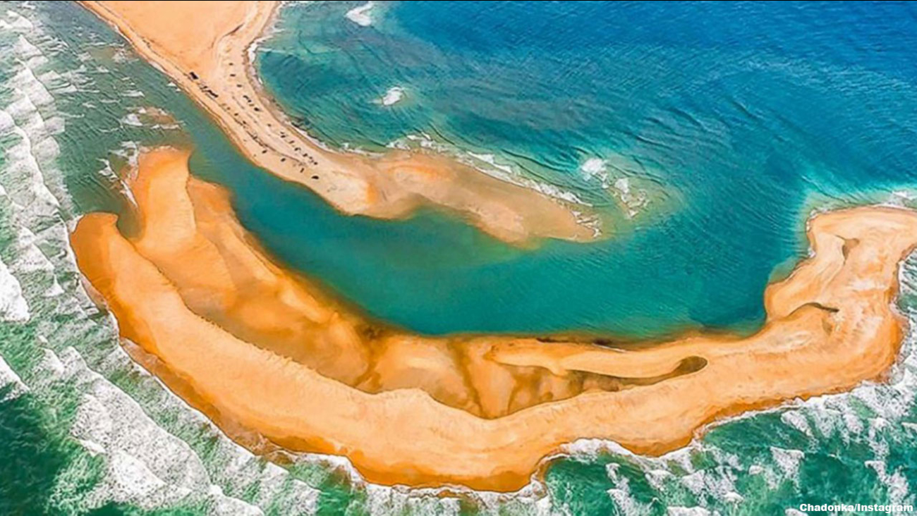 "A new island, being called ""Shelly Island,"" has appeared off the coast of North Carolina near Cape Hatteras."