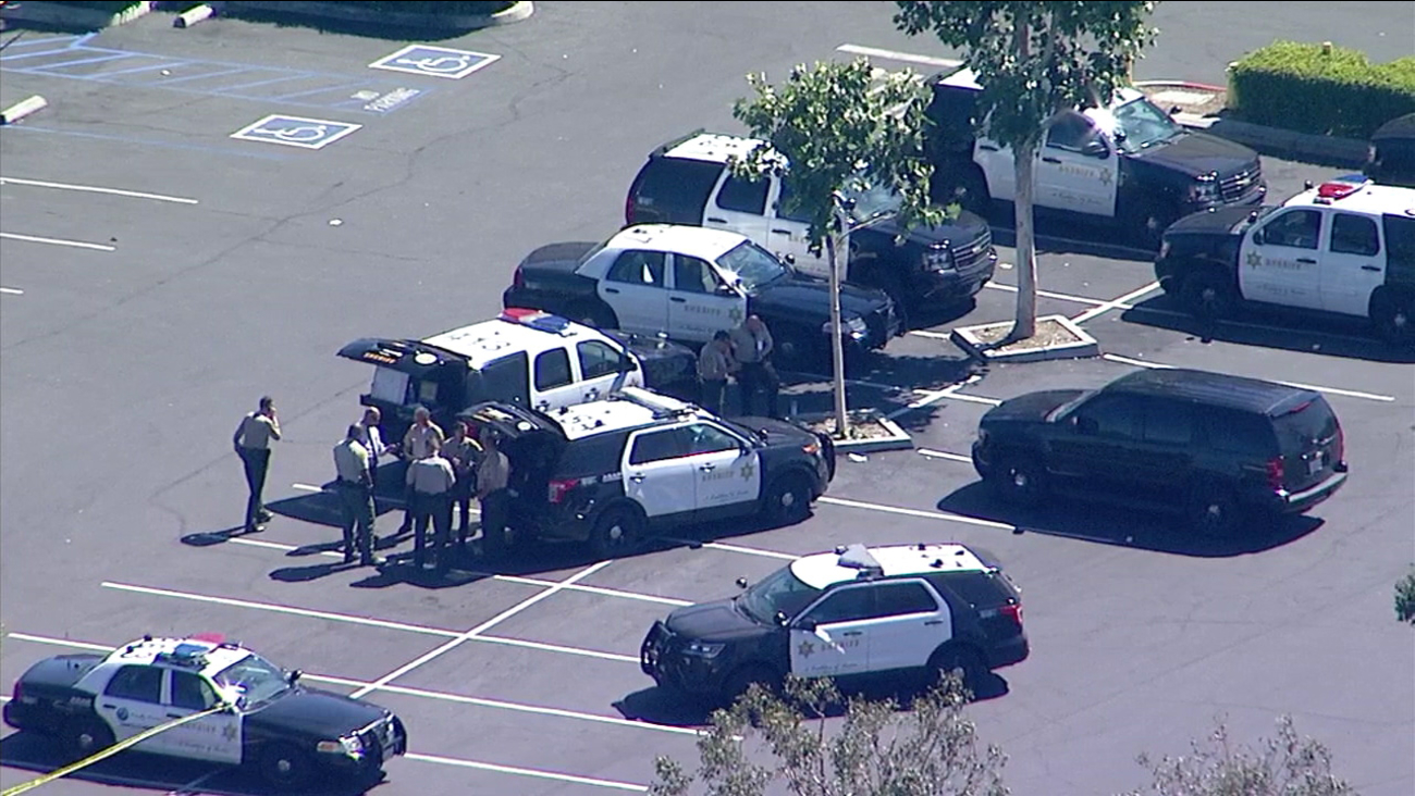 Sheriff's deputies are seen in the parking lot of a Stevenson Ranch shopping center during a standoff with an assault suspect on Tuesday, June 27, 2017.