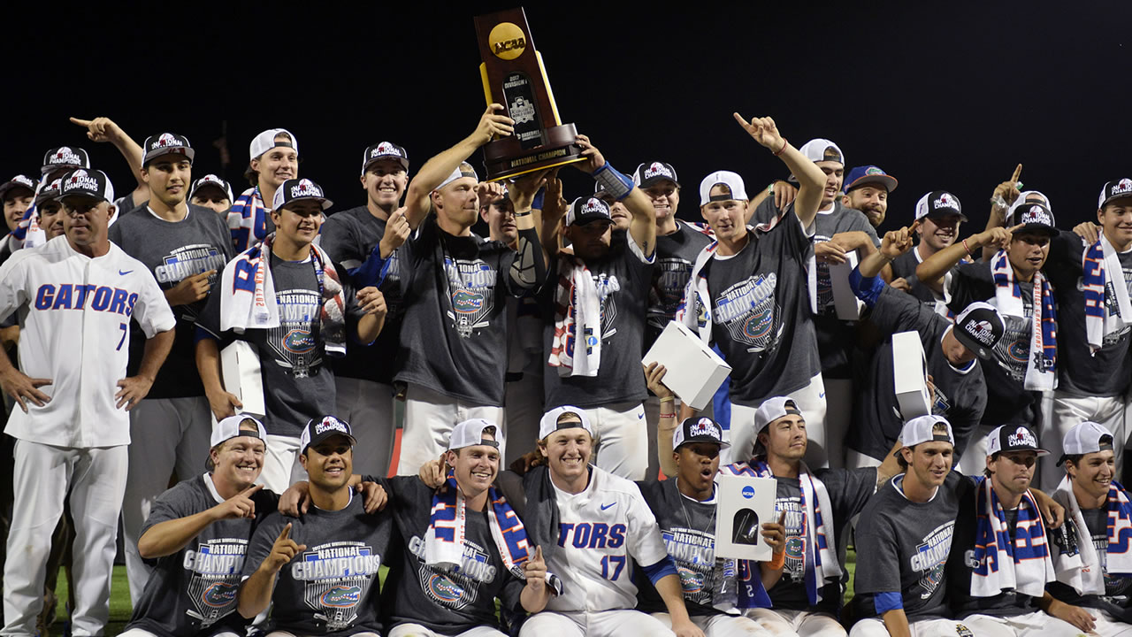 Florida players celebrate with the trophy after defeating LSU in Game 2 to win the NCAA College World Series baseball finals. (AP Photo/Matt Ryerson)