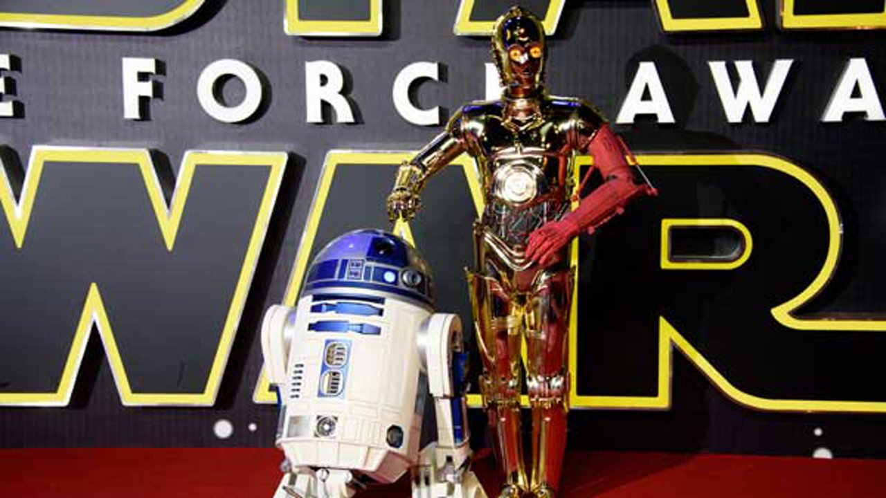 Actors dressed as C3PO and R2D2 pose for photographers upon arrival at the European premiere of the film 'Star Wars: The Force Awakens ' in London, Wednesday, Dec. 16, 2015.