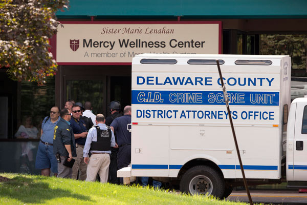 """<div class=""""meta image-caption""""><div class=""""origin-logo origin-image """"><span></span></div><span class=""""caption-text"""">Investigators work the scene of a shooting Thursday, July 24, 2014, at Mercy Fitzgerald Hospital in Darby, Pa.</span></div>"""