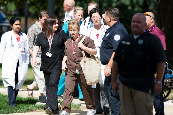 """<div class=""""meta image-caption""""><div class=""""origin-logo origin-image """"><span></span></div><span class=""""caption-text"""">Hospital workers leave the scene of a shooting Thursday, July 24, 2014, at Mercy Fitzgerald Hospital in Darby, Pa. (AP Photo)</span></div>"""