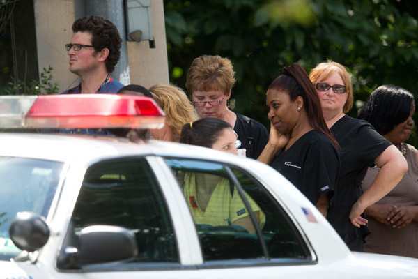"""<div class=""""meta image-caption""""><div class=""""origin-logo origin-image """"><span></span></div><span class=""""caption-text"""">Hospital workers view police activity at the scene of a shooting Thursday, July 24, 2014, at Mercy Fitzgerald Hospital in Darby, Pa. (AP Photo)</span></div>"""