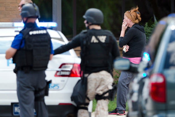 """<div class=""""meta image-caption""""><div class=""""origin-logo origin-image """"><span></span></div><span class=""""caption-text"""">A hospital worker views police activity around the scene of a shooting Thursday, July 24, 2014, at Mercy Fitzgerald Hospital in Darby, Pa. (AP Photo)</span></div>"""