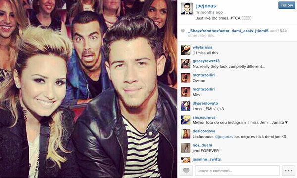 "<div class=""meta image-caption""><div class=""origin-logo origin-image ""><span></span></div><span class=""caption-text"">Joe Jonas photobombs his ex-grilfriend, Demi Lovato, and younger brother, Nick Jonas. (joejonas / Instagram)</span></div>"