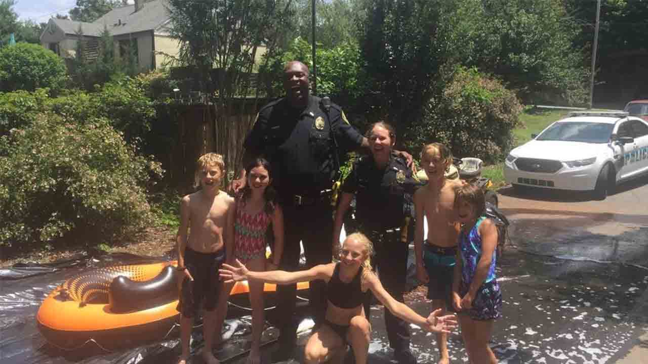 While responding to a call, these officers decided to join in on a 4th of July party
