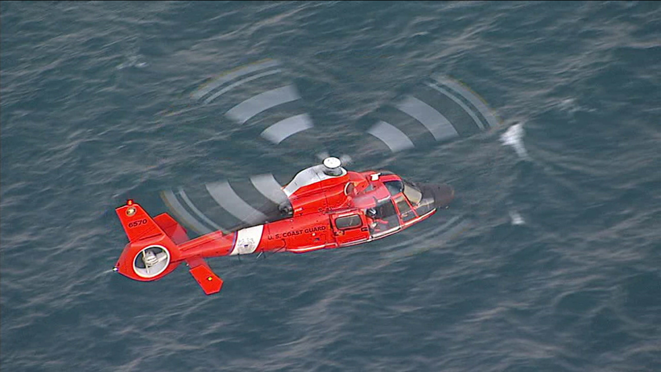 A Coast Guard helicopter is seen over waters off Rancho Palos Verdes after a report of a swimmer in distress on Monday, July 3, 2017.