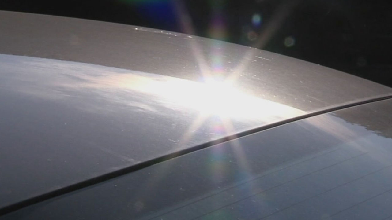 The hot midday sun reflects off a car in this undated file image.