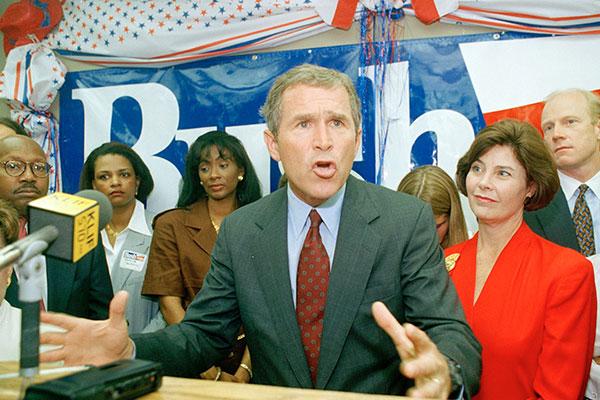 <div class='meta'><div class='origin-logo' data-origin='AP'></div><span class='caption-text' data-credit='Pat Sullivan'>George W. Bush makes a campaign speech during his candidacy for Texas governor on July 18, 1994.</span></div>