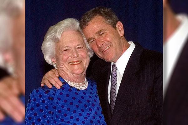 <div class='meta'><div class='origin-logo' data-origin='AP'></div><span class='caption-text' data-credit='David J. Phillip'>Texas Gov. George W. Bush, right, gives his mother, Barbara Bush , a hug after taking a family photo Thursday, June 10, 1999 in Houston.</span></div>