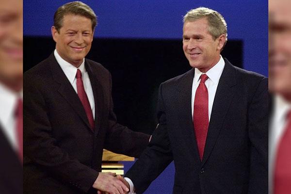 <div class='meta'><div class='origin-logo' data-origin='AP'></div><span class='caption-text' data-credit='Ron Edmonds'>George W. Bush shakes hands with his 2000 presidential election opponent, Al Gore, during a debate on Oct. 3, 2000.</span></div>