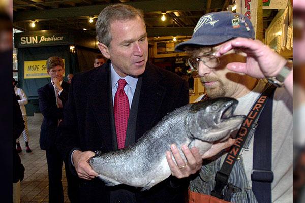 <div class='meta'><div class='origin-logo' data-origin='AP'></div><span class='caption-text' data-credit='Eric Draper'>George W. Bush inspects a Pacific salmon while touring Pike Place Market in Seattle, Nov. 1, 2000.</span></div>