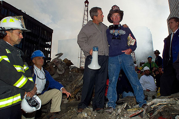 <div class='meta'><div class='origin-logo' data-origin='AP'></div><span class='caption-text' data-credit='Doug Mills'>President Bush stands with firefighter Bob Beckwith on a burnt fire truck in front of the World Trade Center during a tour of the devastation, Sept. 14, 2001.</span></div>