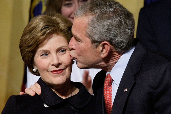 <div class='meta'><div class='origin-logo' data-origin='AP'></div><span class='caption-text' data-credit='Martinez Monsivais'>President Bush, right, kisses his wife first lady Laura Bush, left, after speaking at the 2008 Republican Governors Association gala at the National Building Museum, Feb. 2, 2008.</span></div>