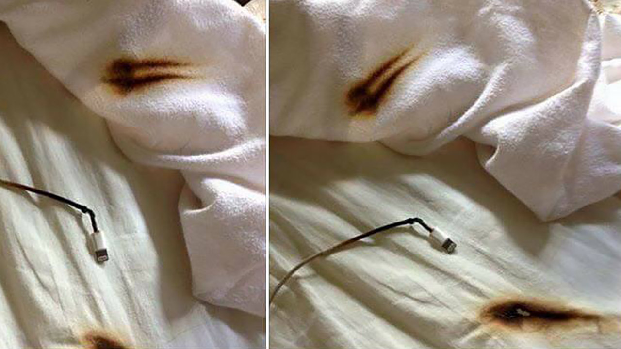 Image of a phone charger burning a bed sheet.