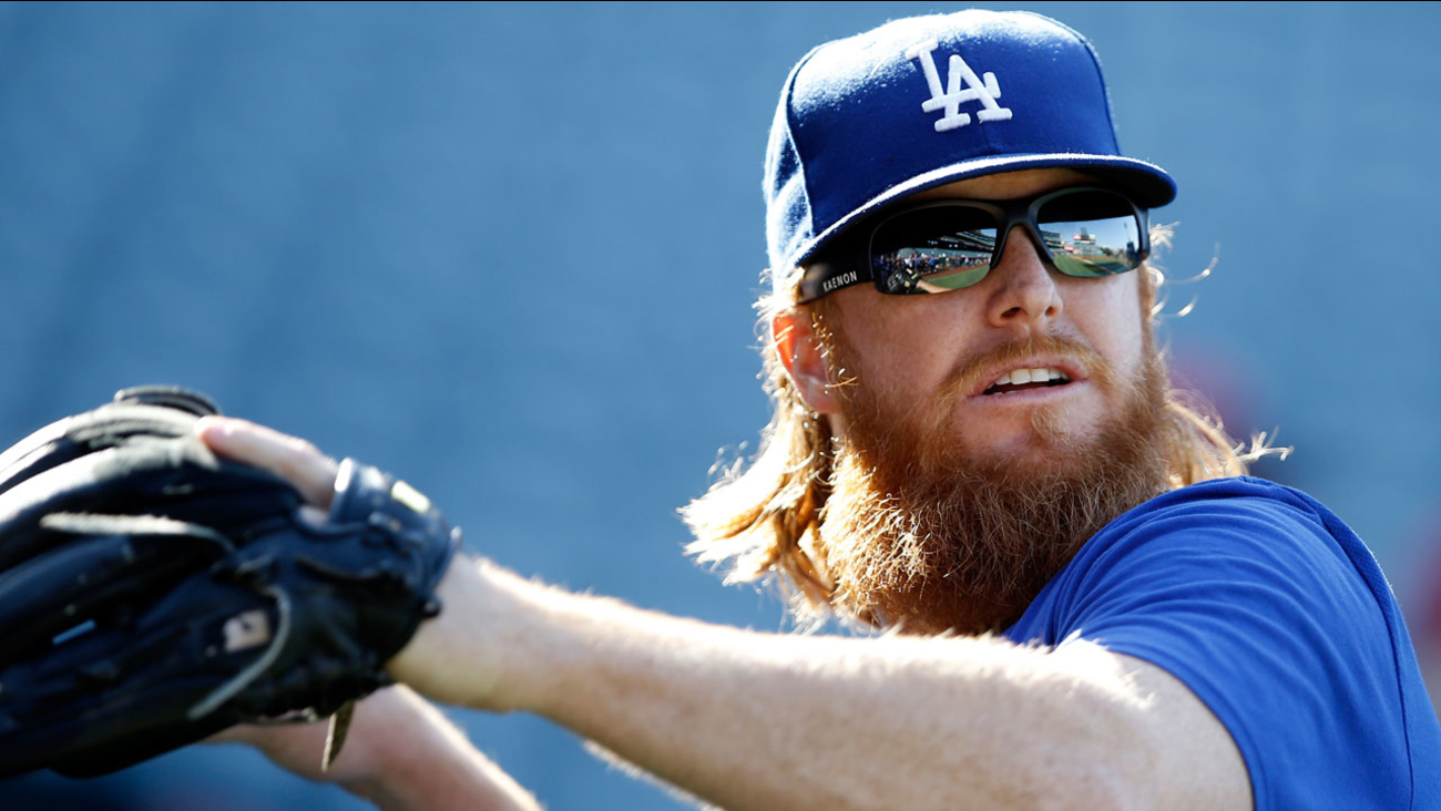 Los Angeles Dodgers' Justin Turner warms up before a baseball game against the Los Angeles Angels in Anaheim, Calif., Thursday, June 29, 2017.