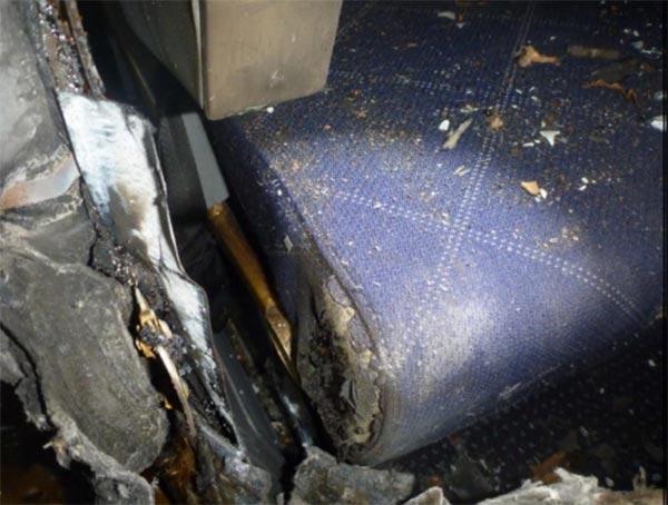 <div class='meta'><div class='origin-logo' data-origin='WLS'></div><span class='caption-text' data-credit='National Transportation Safety Board'>Fig. 57: Seat 34 charred seat cushion</span></div>