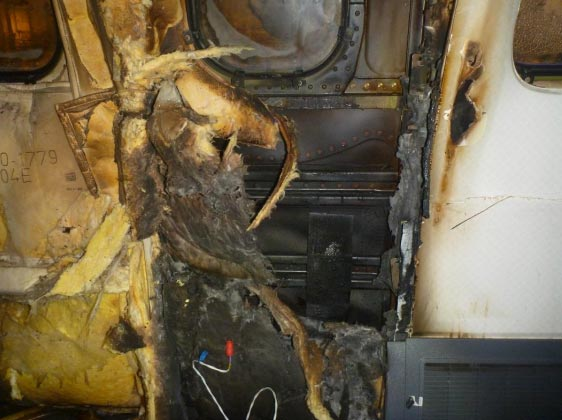 <div class='meta'><div class='origin-logo' data-origin='WLS'></div><span class='caption-text' data-credit='National Transportation Safety Board'>Fig. 61: Charred insulation and CIC on skin at seat 34</span></div>