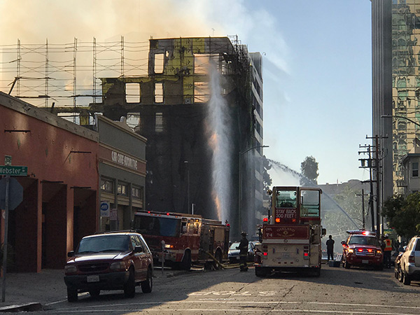 <div class='meta'><div class='origin-logo' data-origin='none'></div><span class='caption-text' data-credit='KGO-TV'>Fire destroys building under construction in Oakland, California, Friday, July 7, 2017.</span></div>