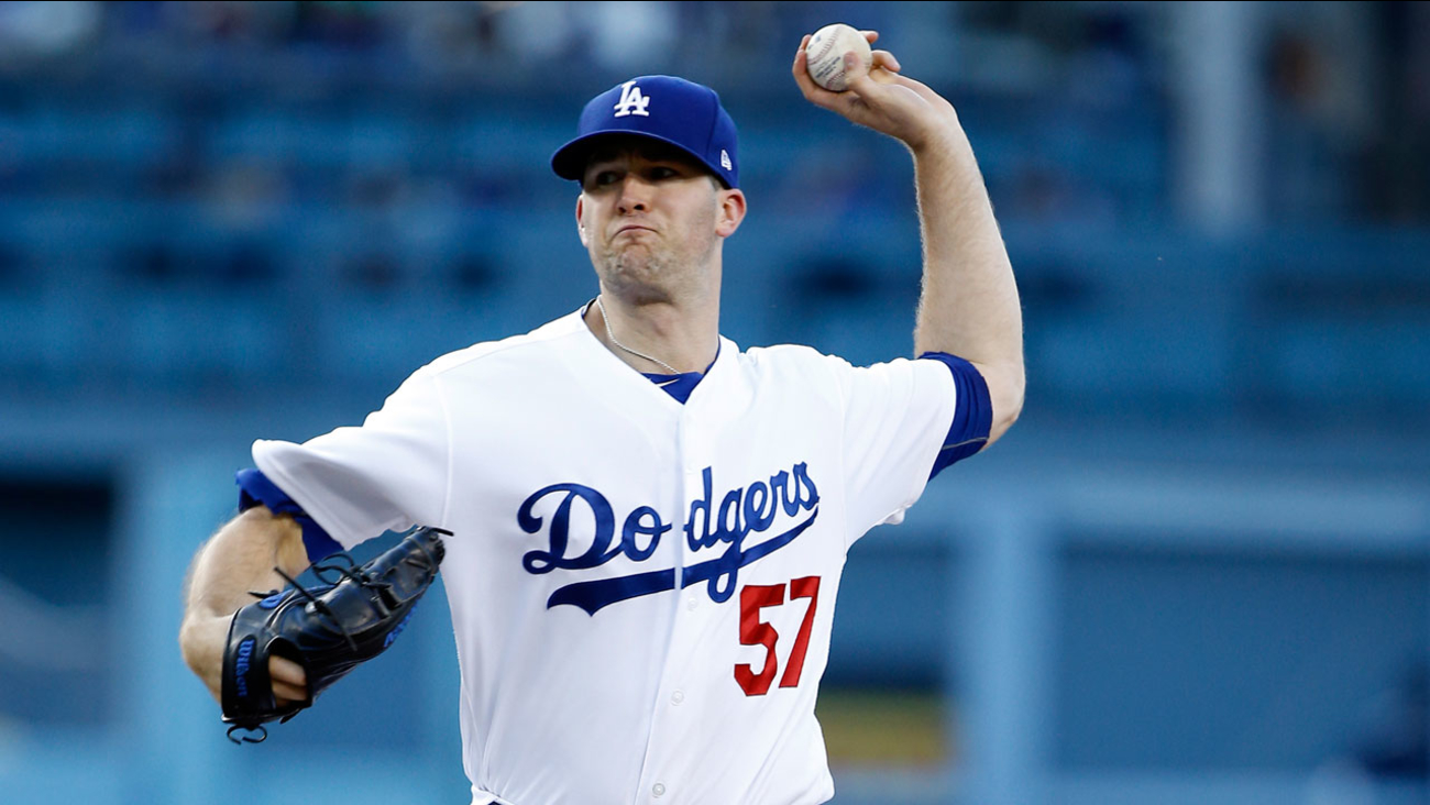 Alex Wood throws to the plate during the first inning of a baseball game against the Arizona Diamondbacks in Los Angeles, Wednesday, July 5, 2017.