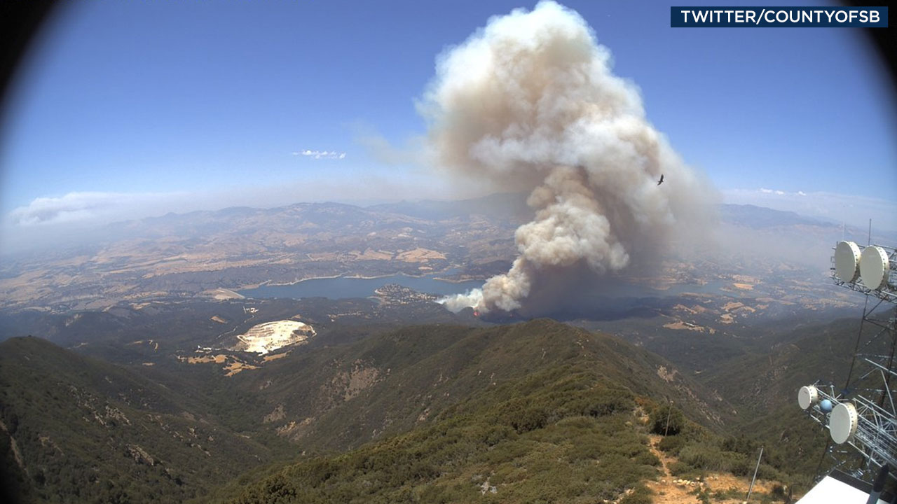 Fire is seen from a stationary camera in Santa Barbara showing plumes of smoke near Lake Cachuma along Highway 154 on Saturday, July 8, 2017.