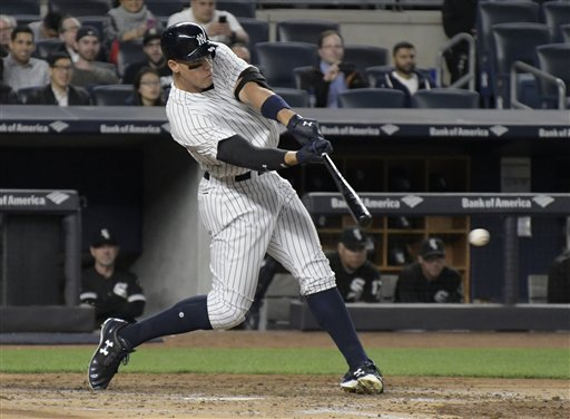 "<div class=""meta image-caption""><div class=""origin-logo origin-image none""><span>none</span></div><span class=""caption-text"">Yankees right fielder Aaron Judge hits a two-run home run during the fifth inning of a baseball game against the Chicago White Sox Monday, April 17, 2017. (AP Photo/Bill Kostroun)</span></div>"