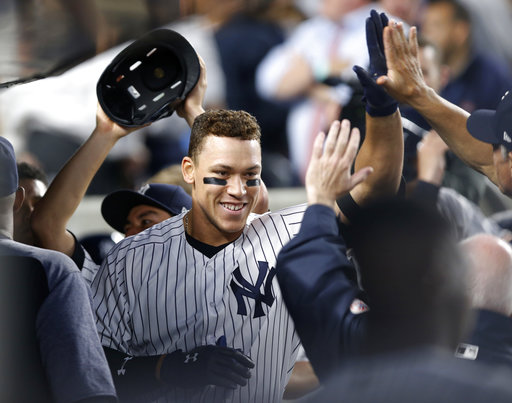 "<div class=""meta image-caption""><div class=""origin-logo origin-image none""><span>none</span></div><span class=""caption-text"">Teammates greet New York Yankees' Aaron Judge in the dugout after he hit a solo home run during the third inning of a baseball game against the Toronto Blue Jays (AP Photo/Kathy Willens)</span></div>"