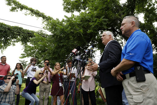 <div class='meta'><div class='origin-logo' data-origin='none'></div><span class='caption-text' data-credit='AP'>Matthew Weintraub, second from right, District Attorney for Bucks County, Pa., speaks to the media during a news conference, Tuesday, July 11, 2017, in Solebury,Pa.  (AP Photo/Matt</span></div>