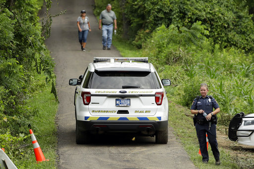 <div class='meta'><div class='origin-logo' data-origin='none'></div><span class='caption-text' data-credit='AP'>Law enforcement officials walk down a blocked off driveway in Solebury, Pa., Tuesday, July 11, 2017. (AP Photo/Matt Slocum)</span></div>