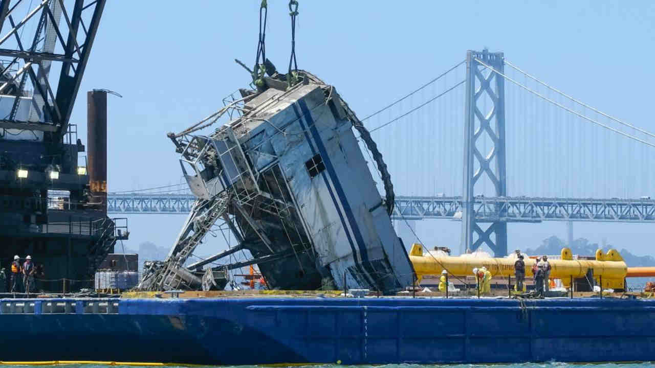 A crane housing from a sunken barge is seen on San Francisco Bay on Tuesday, July 11, 2017.