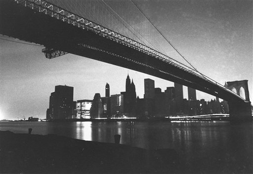 "<div class=""meta image-caption""><div class=""origin-logo origin-image ap""><span>AP</span></div><span class=""caption-text"">The buildings of Manhattan's financial district are dark during the blackout of July 13, 1977 in this file photo taken from under the Brooklyn Bridge. (AP Photo/Ray Stubblebine, File)</span></div>"