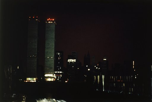 "<div class=""meta image-caption""><div class=""origin-logo origin-image ap""><span>AP</span></div><span class=""caption-text"">The twin towers of the World Trade Center and the southern tip of Manhattan are plunged into near darkness as a massive power failure hits New York City July 13, 1977. (AP Photo/Dave Pickoff)</span></div>"