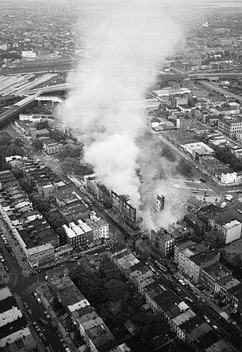 "<div class=""meta image-caption""><div class=""origin-logo origin-image ap""><span>AP</span></div><span class=""caption-text"">This aerial view shows the fires started by looters raging in Brooklyn during the electricity failure that blacked out New York City, July 13, 1977. (AP Photo/Suzanne Vlamis)</span></div>"