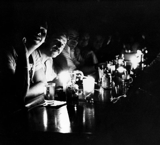 "<div class=""meta image-caption""><div class=""origin-logo origin-image ap""><span>AP</span></div><span class=""caption-text"">People at Chapman's Restaurant in midtown Manhattan continue their drinking by candlelight after New York City had a blackout, July 13, 1977. (AP Photo/Dave Pickoff)</span></div>"