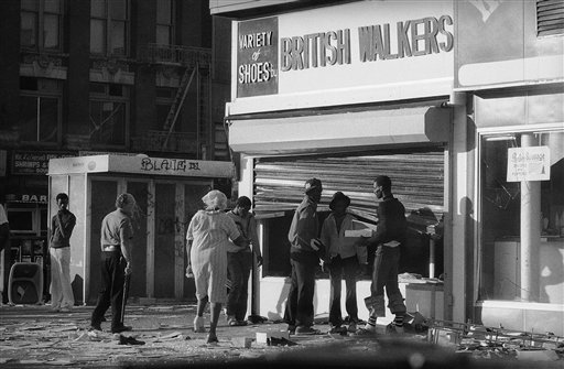 "<div class=""meta image-caption""><div class=""origin-logo origin-image ap""><span>AP</span></div><span class=""caption-text"">Looters in Manhattan's Harlem section reach past a bent security gate to ransack the window of a shoe store. New York Mayor Abraham Beame said some 2,000 people were arrested. (AP Photo/Ed Bailey)</span></div>"