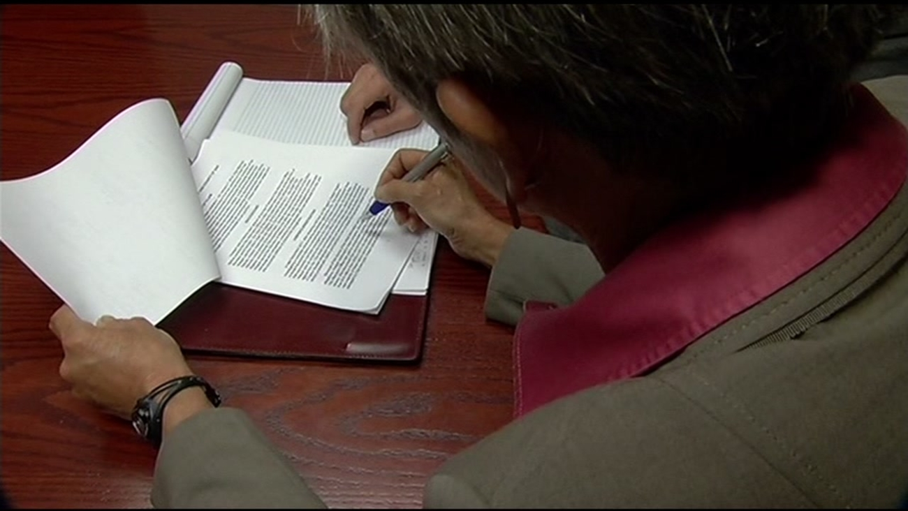 This undated image shows lawyer Joanne Hoeper as she looks at documents in San Francisco.